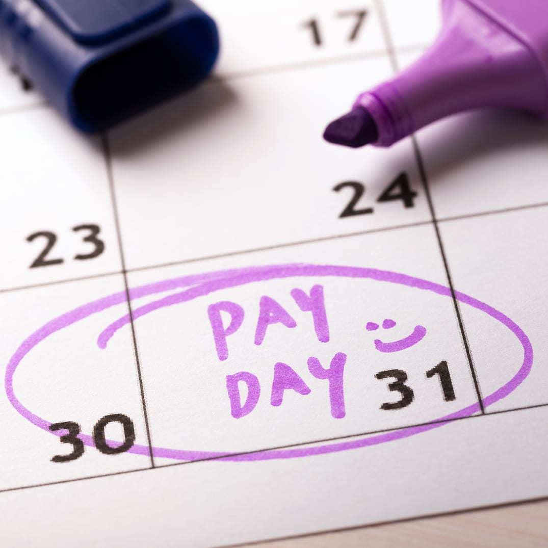 payday concept calendar with marker and circled day of salary