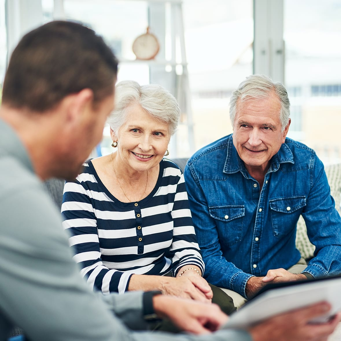 Shot of senior couple having a consultation with a financial advisor at home