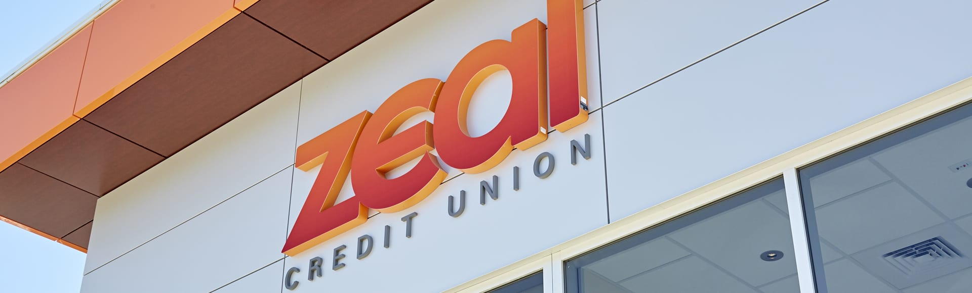 zeal credit union building sign logo