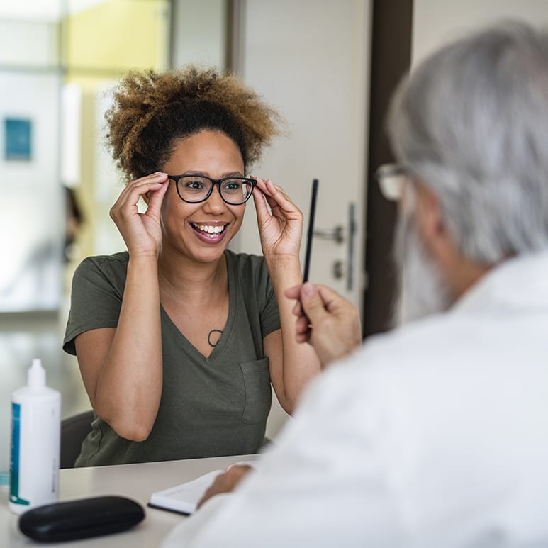 Woman testing out her new eyeglasses in ophthalmology office