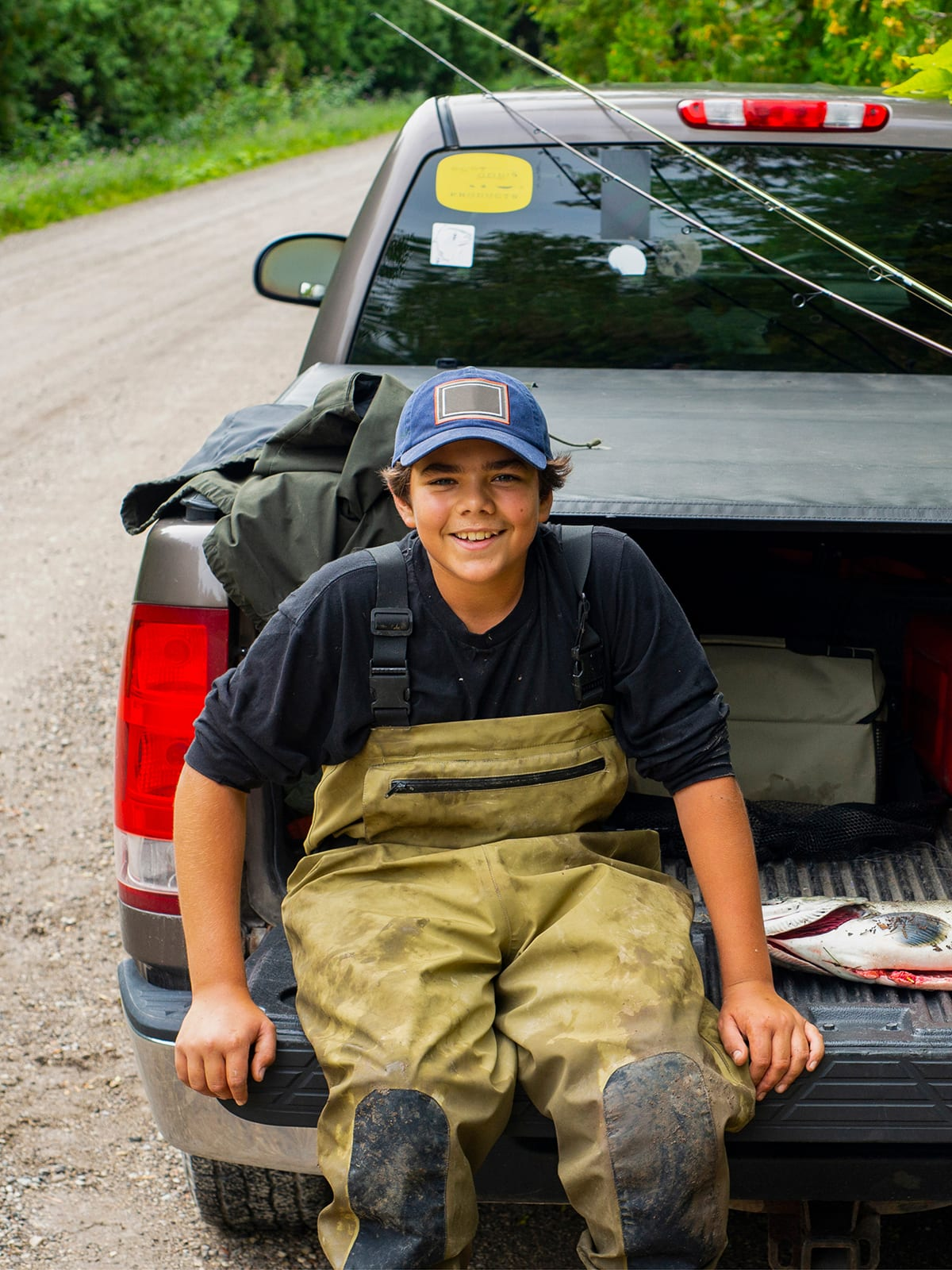 A proud young fisherman with a Chinook Salmon (King Salmon) he has caught. Zeal Credit Union Auto Loan Promo.